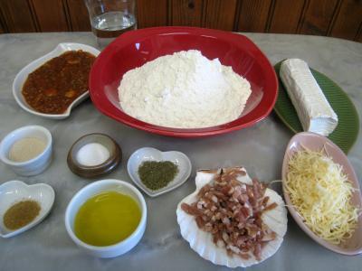 Ingrédients pour la recette : Mini-pizzas à la tomate et au chèvre