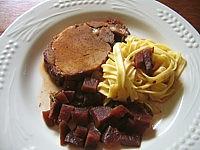 Pôti de porc : Assiette de rôti de porc au Porto