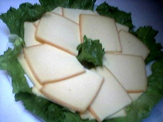 Photo : Tranches de fromage de raclette